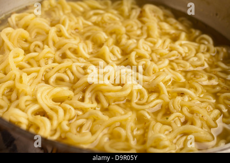 Instant Ramen cooking in a pot - Stock Photo