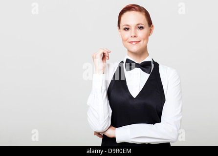 attractive young waitress in uniform - Stock Photo