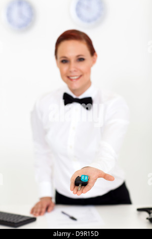 car rental company employee giving car key to customer - Stock Photo