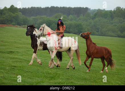 A Native American Indian Man Riding Bareback On His Horse