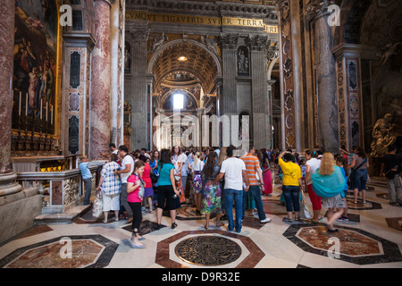 ROME - June 22: Crowd of tourists Indoor St. Peter's Basilica on June 22, 2012 in Rome, Italy. - Stock Photo