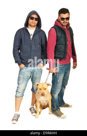 Bad boys with pitbull isolated on white background - Stock Photo
