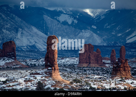 rock stacks in the Windows Section with the La Sal Mountains beyond, Arches National Park, Utah, USA - Stock Photo