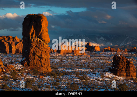 Balanced Rock and the Windows Section with the La Sal Mountains beyond, Arches National Park, Utah, USA - Stock Photo