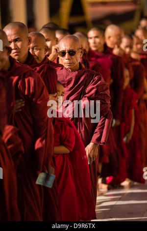 monks at the Shwezigon Paya, Bagan, Myanmar (Burma) - Stock Photo