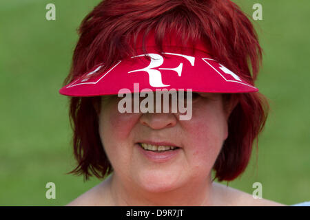 Wimbledon, London, UK. 25th June 2013.  A  fan of Swiss player Roger Federer queues to watch her sporting hero as - Stock Photo