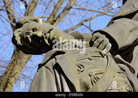 Statue of a dying soldier  in the Tiergarten, Berlin, Gemany. - Stock Photo