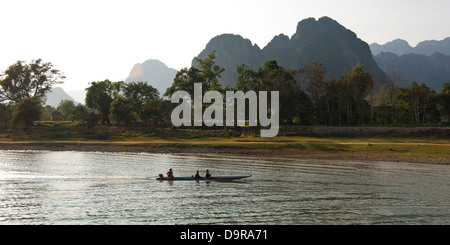 Horizontal panoramic (2 picture stitch) view of Nam Song river and the beautiful scenery in Vang Vieng - Stock Photo