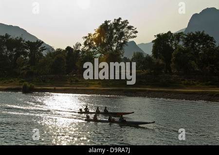 Horizontal view of Nam Song river in Vang Vieng at sunset. - Stock Photo