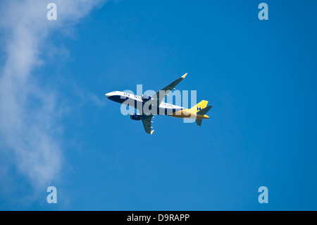 Horizontal close up of a new Monarch airlines Airbus 320 in flight. - Stock Photo