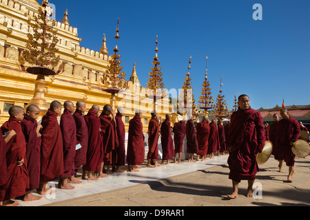 monks at the Shwezigon Paya, Bagan, Myanmar (Burma) - Stock Photo