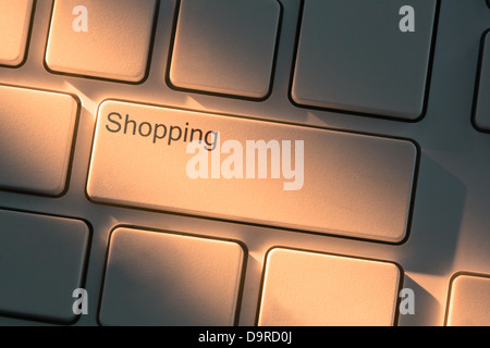 Keyboard with close up on shopping button - Stock Photo