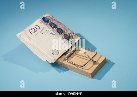 Twenty pound notes in a mousetrap - Stock Photo