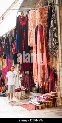 Israel Jerusalem Old City typical street scene clothes shop store hijab robes thobe thorbs abayas scarfs street - Stock Photo