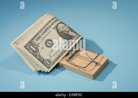 Dollar bills in a mousetrap