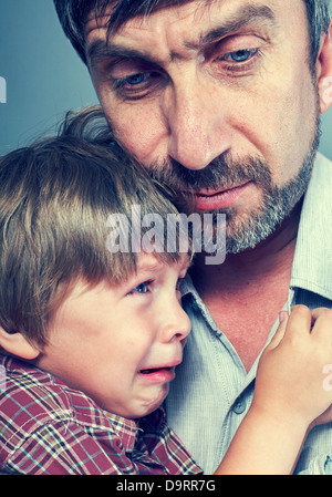 father pities his son - Stock Photo