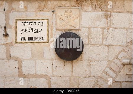 Israel Old City Jerusalem Via Dolorosa Station of the Cross 5 five fifth Simon of Cyrene helps Jesus carry cross - Stock Photo