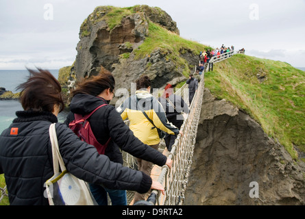 Rope bridge in Carrick-a-Rede, in 'Causeway Route'. Northern Ireland, United Kingdom, Europe. - Stock Photo