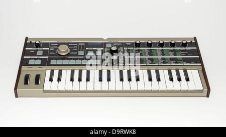 Electronic organ, MIDI keyboard isolated on white background - Stock Photo