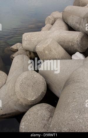 CONCRETE Y SHAPED BLOCKS USED IN CONSTRUCTION OF HARBOUR BREAKWATERS  PUERTO BANUS SPAIN - Stock Photo
