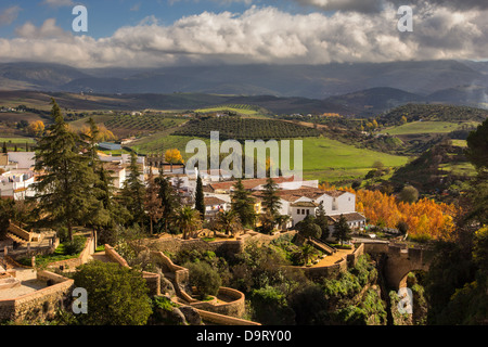 RONDA AND RAIN CLOUDS ON THE SERRANIA DE RONDA HILLS IN AUTUMN ANDALUCIA SPAIN - Stock Photo