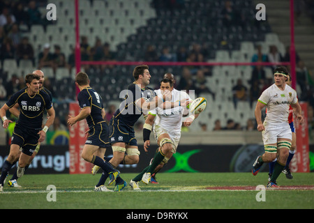 Scottish Jim Hamilton distributing the ball during the Castle Larger Rugby Test between South Africa and Scotland - Stock Photo