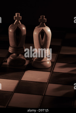 White and black kings on the chessboard - Stock Photo