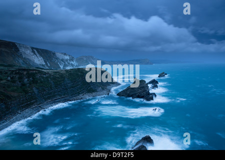 Mupe Bay at dawn on a rough winter morning, Jurassic Coast, Dorset, England, UK - Stock Photo