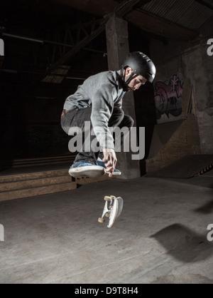 Skater doing 360 trick - Stock Photo
