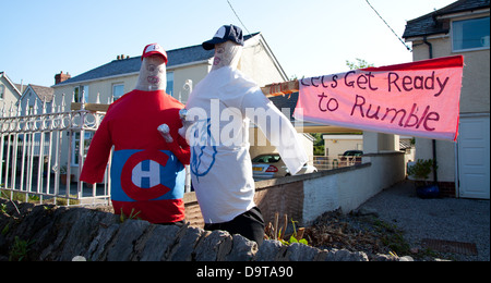 An entry in a scarecrow competition - two characters based on Ant & Dec - with 'Lets get ready to rumble' banner - Stock Photo