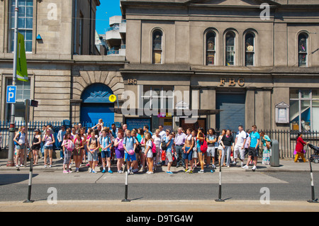 Group of young people waiting for a tram Dublin Ireland Europe - Stock Photo