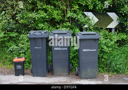 Bins put out in the street for collection. Maidstone, Kent, England. Separate container for food waste - Stock Photo