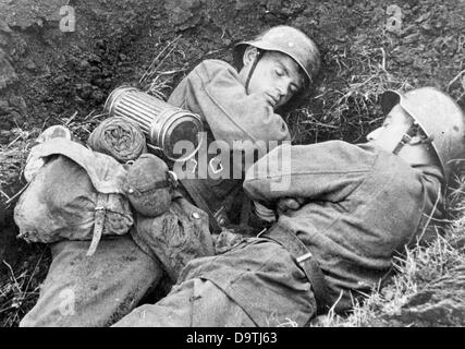The Nazi Propaganda! on the back of the image reads: 'This nap in the lull in combat is well earned!' Image from - Stock Photo