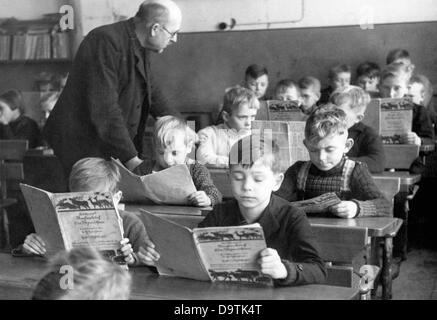 Children who were evacuated as part of the Children's Evacuation Program take part in the school lessons of their - Stock Photo