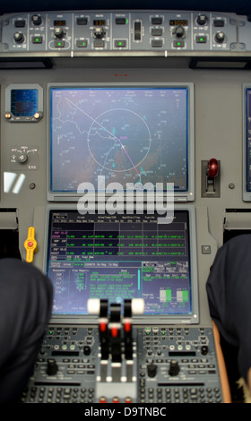 throttle levers and video displays in control panel in the cockpit of a jet plane - Stock Photo