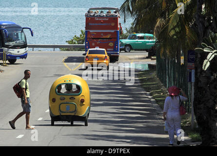 A coach, a ball taxi (coconut taxi), a double-decker and a vintage taxi are pictured in Varadero, Cuba, 22 April - Stock Photo