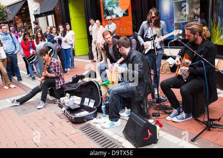 A band performs on grafton street;Dublin city county dublin ireland - Stock Photo