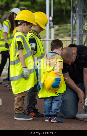 Children helping to build bridge at Institute of Civil Engineers stand at Riveting Stuff festival at the Tees Barrage, - Stock Photo