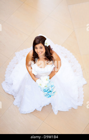 overhead view of a beautiful bride in wedding dress - Stock Photo