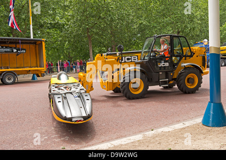 Loading the JCB dieselmax by forklift onto a lorry. - Stock Photo