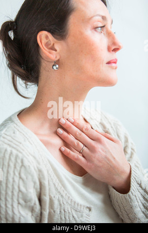 Woman with thyroid goitre Stock Photo, Royalty Free Image