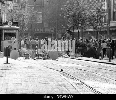 Demonstrators block the rails and throw furniture of a street cafe at a tram on the Zeil in Frankfurt am Main. Demonstrators - Stock Photo