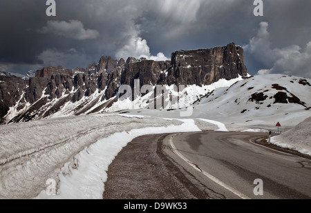 Snow and the Croda da Lago peaks in June 2013 at the summit of the Giau Pass, Dolomites, Italy - Stock Photo