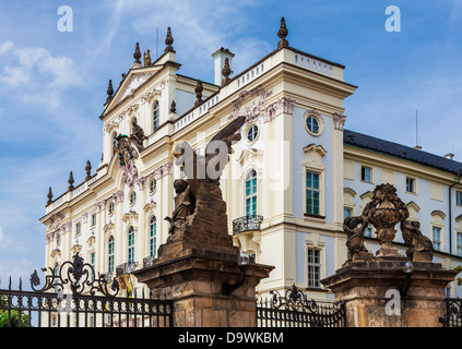 The rococo front facade of the Archbishop's Palace taken from the first Castle (Hrad) courtyard in Prague. - Stock Photo