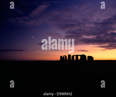A wide landscape view of the Stonehenge trilithons silhouetted after sunset and moonrise.Wiltshire, England - Stock Photo