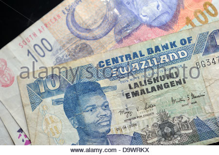 10 Swazi Emalangeni note with 100 Rand note, both currencies legal tender  in Swaziland - Stock Photo