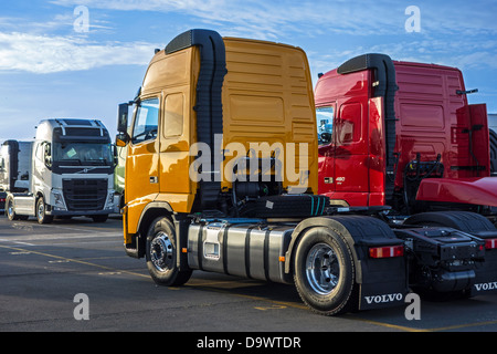 Trucks from the Volvo Trucks assembly plant waiting to be loaded on roll-on/roll-off / roro ship at the Ghent seaport, - Stock Photo