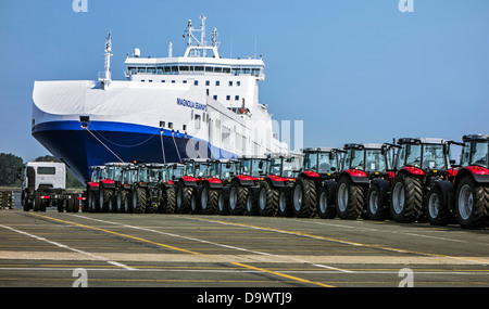 Tractors from the Volvo Trucks assembly plant waiting to be loaded on roll-on/roll-off / roro ship at Ghent seaport, - Stock Photo