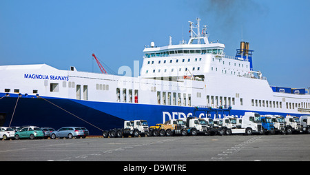 Trucks and cars from the Volvo assembly plant waiting to be loaded on roll-on/roll-off / roro ship at Ghent seaport, - Stock Photo