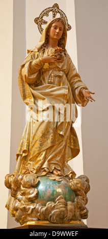 TOLEDO - MARCH 8: Carved and polychrome statue of Virgin Mary in San Idefonso church on March 8, 2013 in Toledo, - Stock Photo